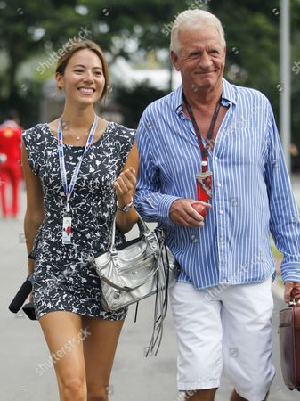 Jessica Michibata (l) Girlfriend of British Formula One Driver Jenson Button of Mclaren Mercedes and Jenson's Father John Button (r) Walk on the Paddock Before the Last Practice Session at the Marina Bay Street Circuit in Singapore 25 September 2010 the Singapore Formula One Grand Prix Night Race Will Be Held 26 September Singapore Singapore