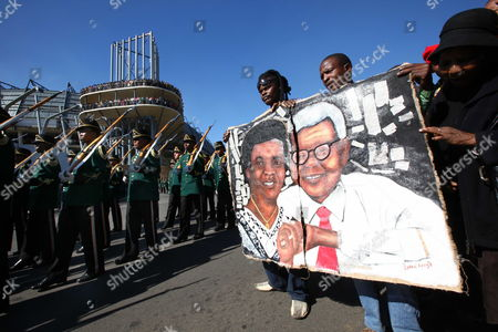Supporters of the Late Late Albertina Sisulu Carry a Painting of Her and Her Late Husband Walter Sisulu As Her Body is Driven Past by Hears to Her Final Resting Place After the State Funeral at the Orland Stadium Soweto Johannesburg South Africa 11 June 2011 Albertina Sisulu was the Wife of the Late Walter Sisulu a Founding Member of the African National Congress (anc) the Liberation Party Led by Nelson Mandela Successfully Ousted the White National Party in 1994 Thus Ending Apartheid and Freeing All Black South African's who Had Previously Had No Right to Vote South Africa Johannesburg