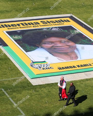 A Priest Walks Past a Huge Poster of the Late Albertina Sisulu During Her State Funeral at the Orland Stadium Soweto Johannesburg South Africa 11 June 2011 Reports State That Albertina Sisulu was the Wife of the Late Walter Sisulu a Founding Member of the African National Congress (anc) the Liberation Party Led by Nelson Mandela Successfully Ousted the White National Party in 1994 Thus Ending Apartheid and Freeing All Black South African's who Had Previously Had No Right to Vote South Africa Johannesburg