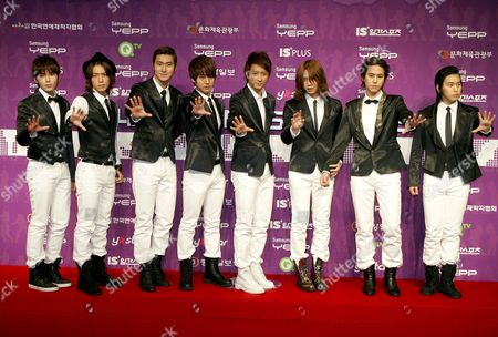 South Korean Dance Group 'Super Junior' Members (l-r) Ryeowook Donghae Siwon Yesung Han Geng Heechul Kyuhyun and Sungmin Pose As They Arrive For the 24th Golden Disk Awards at the Olympic Hall at Seoul's Olympic Park South Korea 10 December 2009 Korea, Republic of Seoul