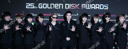 South Korean Dance Group 'Super Junior' Members (l-r) Shindong Ryeowook Sungmin Donghae Heechul Siwon Yesung Eunhyuk Kyuhyun and Leeteuk Pose As They Arrive For the 25th Golden Disk Awards at the Korea University in Seoul South Korea 09 December 2010 Korea, Republic of Seoul