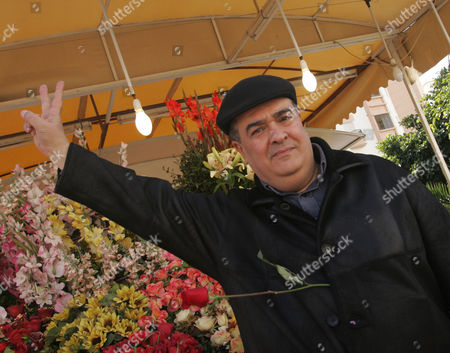 Stock Image of Tunisian Dissident Journalist Taoufik Ben Brik Flashes a 'Victory' Sign As He Poses For a Photograph in Tunis Tunisia 21 January 2011 According to Local Media Reports Ben Brik Has Announced He Would Be Candidate For the Next Presidential Elections in Tunisia Tunisians Began a Three-day National Mourning Period on 21 January in Memory of the Victims of the Latest Events Which Led to the Departure of Former President Zine El-abedine Ben Ali and the Formation of an Interim Government Tunisia Tunis