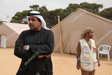 United Arab Emirates Ambassador to Tunis Abdullah Ibrahim Ghanem Al Suwaidi (l) Looks on During a Working Visit at the Uae (united Arab Emirates) Red Crescent Refugee Camp Near the Border Crossing with Libya at Ras Jdir Tunisia 15 April 2011 According to the Camp Officials the Camp Which is Funded by the Uae Has Sheltered Up to 9900 Refugees in Movement at Different Times Since Its Opening Some 742 of Them Were at the Camp During Its Visit on 15 April As Unrest Continues in Libya Hundreds of Thousands of Refugees Are Still Staying at Different Camps in the Area Near the Border Awaiting Either Evacuation to Their Homelands Or to New Countries who Accept to Receive Them if They Come From a Conflict Torn Region with the Help of the Unhcr ( United Nations High Commission For Refugees) and Other Organizations Tunisia Ras Jdir