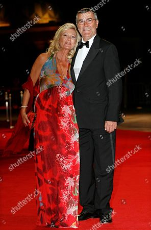 German Tv Presenter Sabine Christiansen (l) and Her Husband Norbert Medus (r) Arrive on the Red Carpet at the Laureus World Sports Awards in Abu Dhabi United Arab Emirates 07 Febuary 2011 the Laureus World Sports Awards Are Awarded Annually to Sports People who Have Been Outstanding During the Previous Year United Arab Emirates Abu Dhabi
