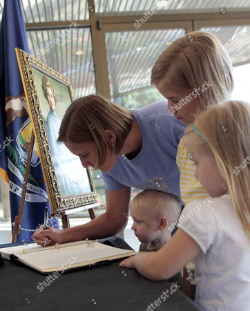 Jennifer Neill Signs the Condolence Book Along with Her Children Adam (2-l) Kelsey (2-r) and Sarah (r) For Betty Ford Wife of Former Us President Gerald Ford at the Gerald Ford Presidential Museum in Grand Rapids Michigan Usa 09 July 2011 Betty Ford Aged 93 Died at the Eisenhower Medical Center in Palm Springs California Near Her Home in Rancho Mirage on 08 July 2011 United States Grand Rapids