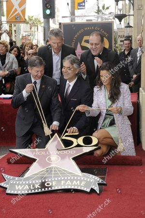 Italian Singer/composer Andrea Bocelli (front C) with Help From Hollywood Chamber of Commerce Ceo Leron Gubler (front-l) and Fiance Veronica Berti (front-r) Unveil Bocelli's Star on the Hollywood Walk of Fame As Canadian Music Producer David Foster (back-l) and Secretary General of the Capri in the World Institute Pascal Vicedomini (back-r) Look on in Hollywood California Usa 02 March 2010 Bocelli was Honored with the 2 402nd Star For His Contributions to the Entertainment Industry United States Hollywood