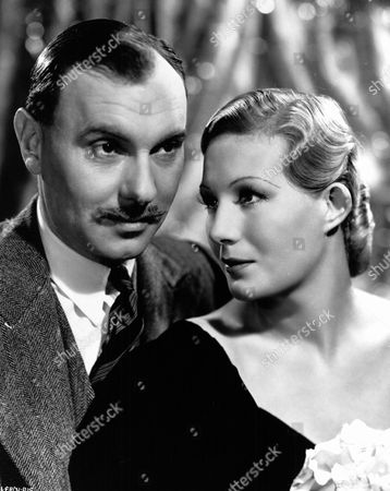 'The Divorce of Lady X'  Film - 1938 - Ralph Ricahrdson (Lord Mere) and His  Wife Lady Claire Mere (Binnie Barnes)