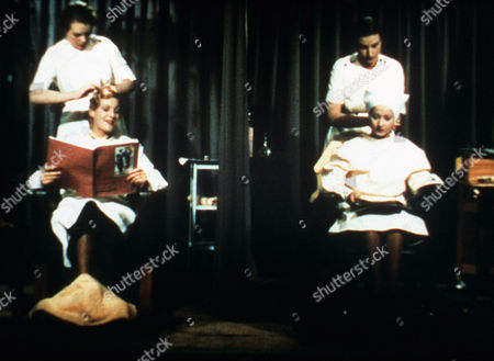 'The Divorce of Lady X'  Film - 1938 - Leslie Steele (Merle Oberon), Right, Has Her Hair Has Hair Washed at the Hairdresser as Her Friend , Lady Claire Mere (Binnie Barnes) Reads a Magazine.