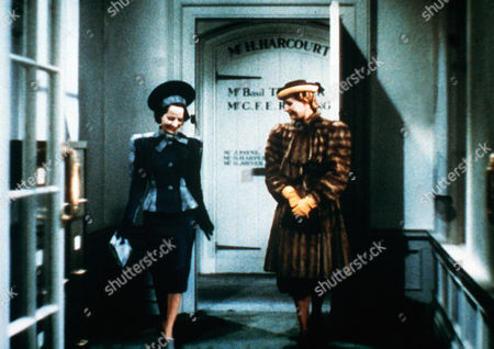 'The Divorce of Lady X'  Film - 1938 -  Leslie Steele (Merle Oberon) Walks Down the Corridor with Her Friend Lady Claire Mere (Binnie Barnes). Both Wear Hats and Coats