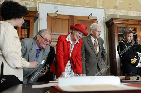 Queen Margrethe Ii (c) of Denmark and Prince Consort Henrik (2-l) of Denmark Look at Books During a Tour of the Library of Congress with Librarian of Congress James H Billington (2-r) in Washington Dc Usa 07 June 2011 United States Washington