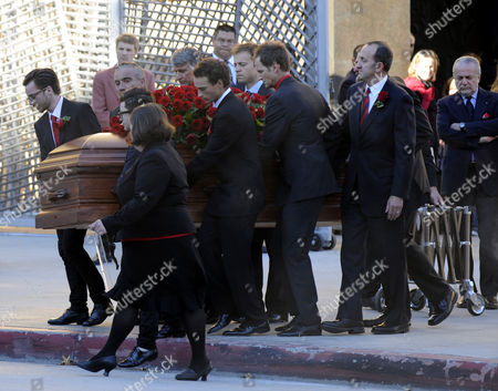 Stock Picture of Pallbearers Roll the Casket Containing the Corpse of Italian Film Producer Dino De Laurentiis to a Hearse For Transport to the Cemetery in Los Angeles California Usa 15 November 2010 De Laurentiis 91 Died Wednesday Night at His Home in Beverly Hills Italian-born De Laurentiis Produced Some 150 Movies in a Career That Spanned Some 70 Years and Included the Works of Italian Masters Federico Fellini and Roberto Rossellini to Hollywood Epics Such As Serpico Three Days of the Condor Death Wish Blue Velvet and the Much-maligned 1976 Remake of King Kong United States Los Angeles