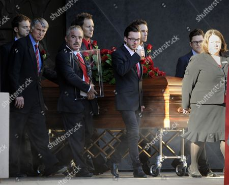 Stock Photo of Pallbearers Roll the Casket Containing the Corpse of Italian Film Producer Dino De Laurentiis to a Hearse For Transport to the Cemetery in Los Angeles California Usa 15 November 2010 De Laurentiis 91 Died Wednesday Night at His Home in Beverly Hills Italian-born De Laurentiis Produced Some 150 Movies in a Career That Spanned Some 70 Years and Included the Works of Italian Masters Federico Fellini and Roberto Rossellini to Hollywood Epics Such As Serpico Three Days of the Condor Death Wish Blue Velvet and the Much-maligned 1976 Remake of King Kong United States Los Angeles