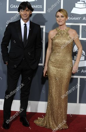 Italian Fashion Designer Frida Giannini (r) and Gucci President and Ceo Patrizio Di Marco (l) Arrive For the 53rd Annual Grammy Awards at Staples Center in Los Angeles California Usa 13 February 2011 United States Los Angeles