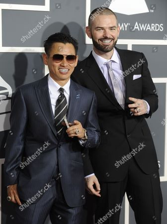 Us Music Artists Paul Wall (r) and Johnny Dang (aka Tvjohnny) Arrive For the 53rd Annual Grammy Awards at Staples Center in Los Angeles California Usa 13 February 2011 United States Los Angeles