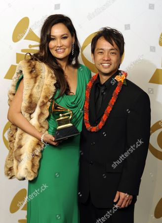 Us Singer Tia Carrere (l) and Us Producer Daniel Ho with Their Award For Best Hawaiian Music Album in the Photo Room at the 53rd Annual Grammy Awards at Staples Center in Los Angeles California Usa 13 February 2011 United States Los Angeles