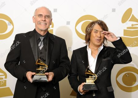Recording Artists Larry Carlton (l) of the Us and Tak Matsumoto of Japan Hold Their Awards For Best Pop Instrumental Album For Take Your Pick in the Photo Room at the 53rd Annual Grammy Awards at Staples Center in Los Angeles California Usa 13 February 2011 United States Los Angeles