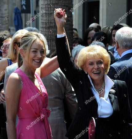 Us Actress Sharon Stone (l) Raises the Arm of Us Singer Jane Morgan (r) Prior to a Ceremony Honoring Morgan with a Star on the Hollywood Walk of Fame in Hollywood California Usa 06 May 2011 Morgan Received the 2439th Star on the Hollywood Walk of Fame United States Hollywood