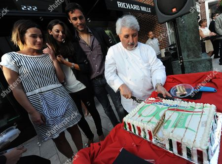 Renowned Italian Chef Celestino Drago (r) From Sicily Cuts a Cake As Italian Actors Martina Codescasa (l) Daniele Pecci (2-r) and British Actress Katy Saunders (2-l) Watch During an Event Celebrating the 150th Anniversary of Italian Reunification in Beverly Hills California Usa 23 June 2011 United States Beverly Hills