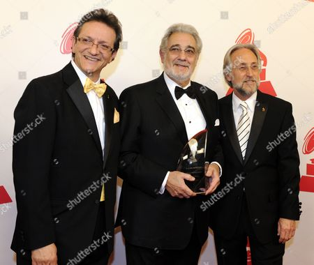 Tenor Placido Domingo From Spain (c) Holds the Latin Recording Academy Person of the Year Award As He Arrives For the Tribute That Will Honor Him in Las Vegas Nevada Usa 10 November 2010 Next to Him Are Gabriel Abaroa Jr (l) Latin Recording Academy President and Producer Emilio Estefan Jr (r) the Person of the Year Tribute is Held in Conjunction with the Latin Grammy Awards Which Recognizes Artistic And/or Technical Achievement not Sales Figures Or Chart Positions the Winners Are Determined by the Votes of Their Peers the Qualified Voting Members of the Academy United States Las Vegas