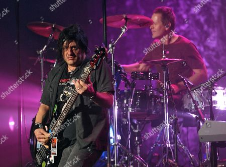 Robbie Takac (l) and Mike Malinin (r) of the Us Band the Goo Goo Dolls Perform at the Murat Theater in Indianapolis Indiana 07 October 2010 United States Indianapolis