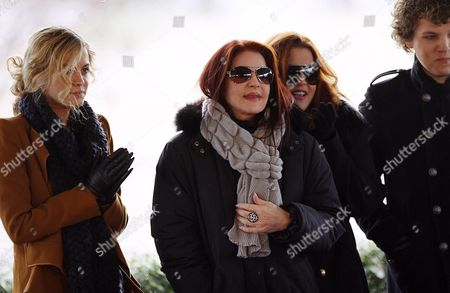 Priscilla Presley Center and Lisa Marie Right Stand with Riley Keough Left and Benjamin Keough During the Celebration of what Would Have Been Entertainer Elvis Presley's 75th Birthday Near Graceland His Memphis Tennessee Usa Home 08 January 2010 the Keoughs Are Lisa Marie's Children - Elvis' Grandchildren Elvis Died at Age 42 in 1977 Thousands of Fans From Around the World Make Pilgrimages Each Year to Honor Their Hero United States Memphis