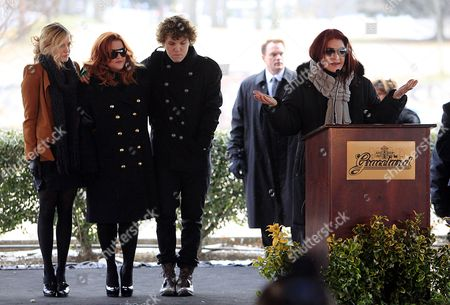 Three Generations of Presleys Take to the Stage During the Celebration of what Would Have Been Entertainer Elvis Presley's 75th Birthday Near Graceland His Memphis Tennessee Usa Home 08 January 2010 From Left Are Riley Keough Lisa Marie Benjamin Keough and Priscilla Presley the Keoughs Are Lisa Marie's Children Elvis Died at Age 42 in 1977 Thousands of Fans From Around the World Make Pilgrimages Each Year to Honor Their Hero United States Memphis