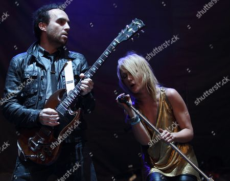 Bassist Josh Winstead (l) and Vocalist Emily Haines (r) of the Canadian Indie Rock and New Wave Band Metric Perform at the Voodoo Music Experience New Orleans Louisiana Usa 29 October 2010 United States New Orleans