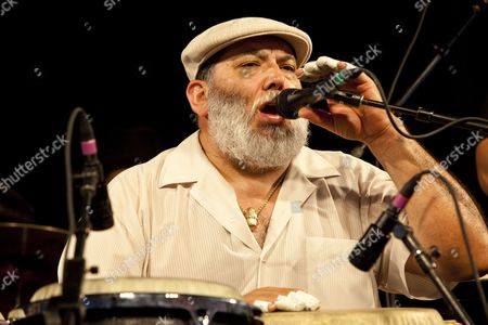 Latin Jazz Band Leader Conga Player and Salsa Singer Poncho Sanchez Performing on the Wwoz Jazz Tent Stage at the New Orleans Jazz and Heritage Festival at the New Orleans Fair Grounds Race Course in New Orleans Louisiana Usa 01 May 2009 New Orleans Jazz and Heritage Festival Or Jazzfest Celebrates It's 40th Anniversary This Year with 12 Different Stages in an Annual 7-day Cultural Event That Encompasses Every Style Associated with the City of New Orleans Including Jazz Gospel Cajun Zydeco Blues Rhythm and Blues Rock Funk African Latin Caribbean Folk and Much More in Addition to Food Booths with Local Cuisine Exhibits Arts and Crafts United States New Orleans