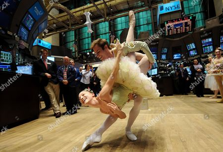 Stock Picture of Ashley Bouder (l) and Andrew Veyette Dancers From the New York City Ballet's Production of 'George Balanchine's Nutcracker' Perform During a Visit the Floor of the New York Stock Exchange in New York City New York Usa 23 December 2010 the Company is Performing the Traditional Holiday Ballet Until 02 January 2011 United States New York