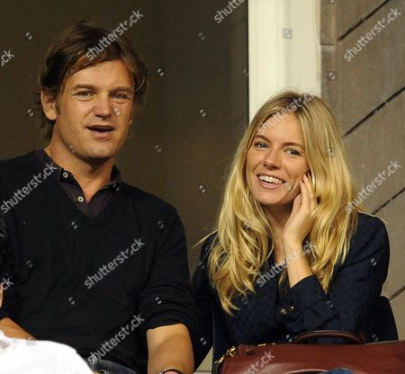 Us Actress Sienna Miller Sits with George Barker Also Known As Dj Slinky Wizard During the Fifth Day of the 2009 Us Open Tennis Championship at the Usta National Tennis Center in Flushing Meadows New York Usa 04 September 2009 the Open Runs Through Sunday 13 September 2009