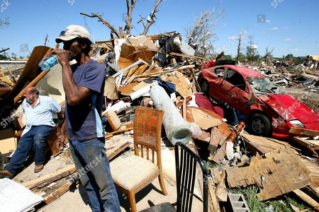 Napoleon Mcewen (l) and Danny Martin (r) Sit Near One of Mcewen's Destroyed Homes in Tuscaloosa Alabama Usa on 28 April 2011 Over a 100 People Have Been Confirmed Dead in the State After Deadly Tornados Destroyed Homes and Businesses Yesterday United States Tuscaloosa