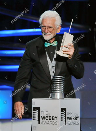 Inventor of the Mobile Phone Martin Cooper Accepts His Award Onstage During the 15th Annual Webby Awards at Hammerstein Ballroom in New York City on 13 June 2011 in New York City Martin a Pioneer in the Wireless Communications Industry an Inventor Entrepreneur and Executive Responsible For Creating the First Portable Cellular Phone in 1973 He is Cited in the Guinness Book of World Records For Making the First Cellular Telephone Call United States New York
