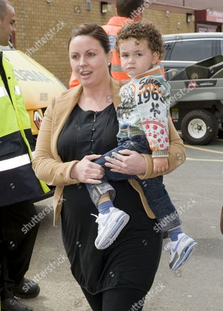 Rio Ferdinand's girlfriend Rebecca Ellison and son Lorenz arrive at Old Trafford.