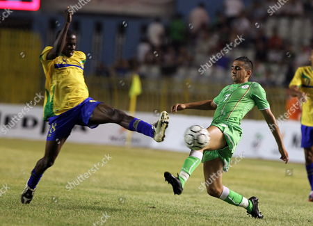 Algerian Player Ryad Boudebouz (r) Fights For the Ball with Gabon's Daniel Cousin (l) During Their Friendly Soccer Match at the 5 Juillet Stadium in Algiers Algeria 11 August 2010 Gabon Won 2-1 Algeria Algiers