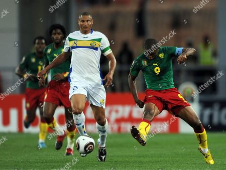 Daniel Cousin of Gabon (l) and Samuel Eto'o of Cameroon (r) Fight For the Ball During the Africa Cup of Nations Group C Match Between Cameroon and Gabon in Lubango Angola 13 January 2010 Angola Lubango