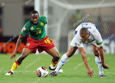 Enoh Eyong of Cameroon (l) and Daniel Cousin of Gabon (r) in Action During the Africa Cup of Nations Group C Match Between Cameroon and Gabon in Lubango Angola 12 January 2010 Angola Lubango
