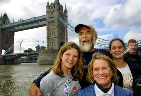 London United Kingdom: Jim Shekhtar (top Centre) Poses For a Photograph with His Family Wife Jane (foreground) Daughters Anna (l) and Sarah (r) Beside Tower Bridge in London 09 April 2001 Shekhtar was the First Man to Row Across the Pacific Ocean Non-stop and Unaided Shekhtar is Back in the Uk After Completing His Personal Challenge Which Took 274 Days to Row the 10 000 Miles From Peru to Australia During His Voyage Shekhtar Encountered Sharks As Well As Being Nearly Rammed by an Oil Tanker
