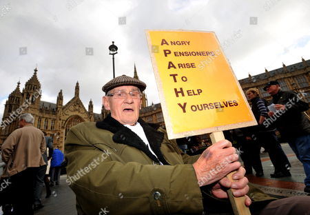Eighty-year-old Norman Lloyd From Exeter in South-west England Joins Around a Hundred Protesters Mainly Pensioners During a Demonstration Organised by the National Pensioners' Convention Near the Houses of Parliament in Central London Britain 27 October 2010 They Were Demonstrating Against Government Cuts in Public Services and Proposed Changes in the State Pension System United Kingdom London