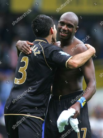 Wigan Captain Antonin Acaraz (l) Congratulates Team Mate Emmerson Boyce (r) at the Final Whistle of the English Premier League Soccer Match Played Between Tottenham Hotspur Fc and Wigan Athletic Fc at Tottenham's White Hart Lane Stadium North London England 28 August 2010 United Kingdom London