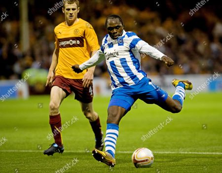 Peter Utaka (r) of Odense Bk is Challenged by Motherwell's Mark Reynolds (l) During Their Uefa Europa League Play-off 2nd Leg Soccer Match at Fir Park in Motherwell Scotland Britain 26 August 2010 United Kingdom Glasgow