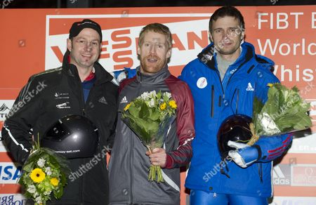 Silver Medalist Kristan Bromley of Great Britain (l) Gold Medalist Jon Montgomery of Canada (m) and Bronze Medalist Alexander Tretiakov of Russia (r) Celebrate Their Wins in the Men's Skeleton Competition at the 2010 Viessmann Fibt World Cup Skeleton in Whistler Canada 26 November 2010 Canada Whistler