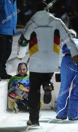 Michi Halilovic of Germany Sits on the Track After His Run in Heat 3 of the Men's Skeleton Event in the Whistler Sliding Centre 19 February 2010 at the Vancouver 2010 Olympic Games Canada Whistler