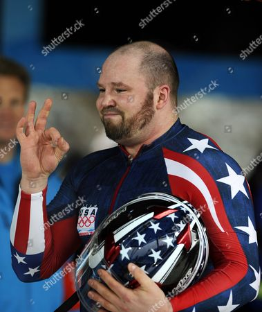 Pilot Steve Holcomb of the Usa-1 Team Greets Spectators During Heats of the Men's Four-man Bobsleigh Competition at the Vancouver 2010 Olympic Games in Whistler Canada 27 February 2010 Canada Whistler