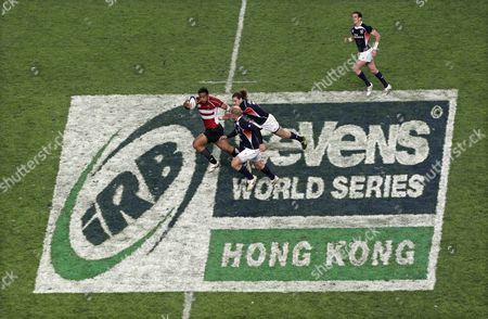 Japan's Pohiva Lotoahea (l) is Tackled by Todd Clever (c) From the Usa During the Ir Match at the Hong Kong Sevens Rugby Union Tournament in Hong Kong China 25 March 2011 the Usa Won 24-19 the Hong Kong Rugby Sevens Will Take Place Until March 27 China Hong Kong