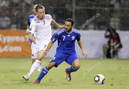 Norway Player Bjorn Helge Riise (l) Vies For the Ball with Cyprus Player Aloneftis Efstathios (r) During Their Match For the Uefa Euro 2012 Group H Qualifying Held at Antonis Papadopoulos Stadium in Larnaca Cyprus 08 October 2010 Cyprus Larnaca