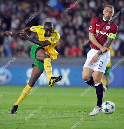 Mamodou Ceesay (l) Takes a Shot on Goal Next to Tomas Repka (r) of Sparta Prague During Their Uefa Champions League Play-off First Leg Soccer Match in Prague Czech Republic 17 August 2010 Czech Republic Prague