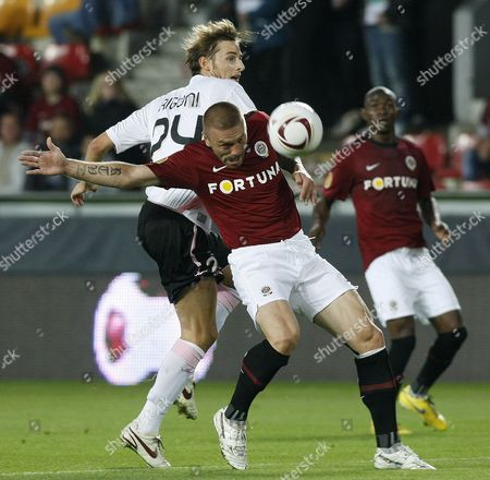 Nicola Rigoni (l) of Palermo Vies For the Ball with Tomas Repka (r) of Sparta Prague During Their Uefa Europa League Match Match in Prague Czech Republic 16 September 2010 Czech Republic Prague