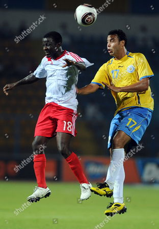 Egypt's Ismaily Player Ahmed Samir Farg (r) Fights For the Ball with Nigerian's Heartland Fc Player Ikechukwu Ezenwa (r) During Their First Round Soccer Match of the African Champions League (caf) at the Ismaliya Stadium in Ismailya Egypt 15 August 2010 Egypt Ismailya