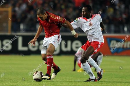 Egyptian Side Al-ahly's Shehab El-din Ahmed (l) Shields the Ball From Nigerian Side Heartland Fc's Ikechukwu Ezenwa (r) During Their First Round Soccer Match of the African Champions League (caf) at the Cairo Stadium in Cairo Egypt 12 September 2010 Egypt Cairo