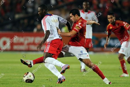Egyptian Side Al-ahly's Ahmed Fathy (r) Tackles Nigerian Side Heartland Fc's Ikechukwu Ezenwa (r) During Their First Round Soccer Match of the African Champions League (caf) at the Cairo Stadium in Cairo Egypt 12 September 2010 Egypt Cairo